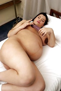 Nasty Pregnant Latina Having Fun With Her Giant Boobies And Belly While Stuffing A Sex Toy Into Her Beaver