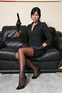 Secretary In Her Office Uniform And Beretta Gun
