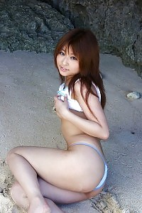 Asian Plage Beauty Demonstrates Her Magnificent Form Naked At The Sandy Beach In The Sun