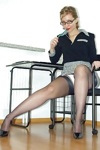 Kirsty Exposes Her Good-looking White Panties In Her Office