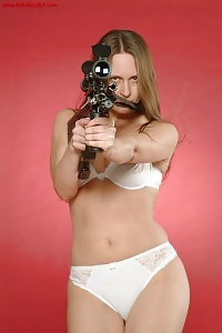 Bikini Corrine With Gun
