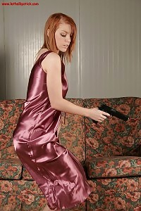 Flirtatious Nathalia Poses On Her Sexy Satin Dress With A Gun
