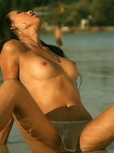 Liza C - Sexy hot wet babe gets totally nude on the beach!